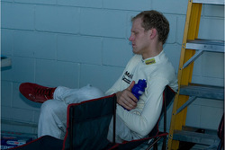 Jorg Bergmeister finds a place to rest in the pits