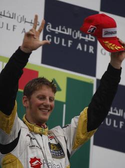 Romain Grosjean celebrates victory