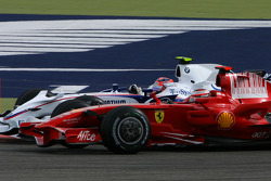 Robert Kubica, BMW Sauber F1 Team, F1.08 and Kimi Raikkonen, Scuderia Ferrari, F2008