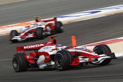Takuma Sato, Super Aguri F1, SA08 leads Anthony Davidson, Super Aguri F1 Team, SA08