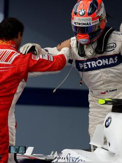 Race winner Felipe Massa celebrates with Robert Kubica