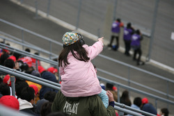 A young fan watches the race
