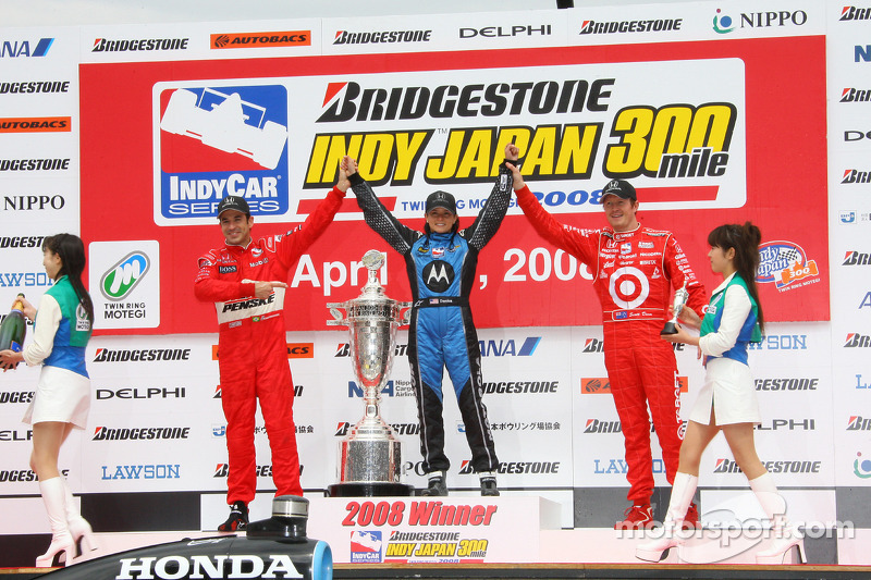 Podium: race winner Danica Patrick with Helio Castroneves and Scott Dixon