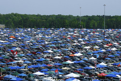 Race fans tailgate in the parking lots