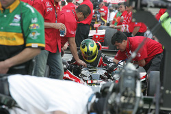 Bruno Junqueira slides in the car in the qualifying line