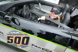 Sarah Fisher puts on her seat belt in the 2008 Indianapolis 500 Chevrolet Corvette Pace Car after participating a press conference for the Indiana state Click It or Ticket seat-belt enforcement program