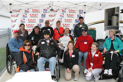 Sam Schmidt poses for photos with fans