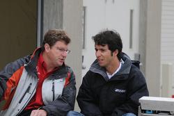 Bruno Junqueira talking to a crew member