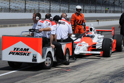Ryan Briscoe's stopped in pitlane, so his crew had to come tow it