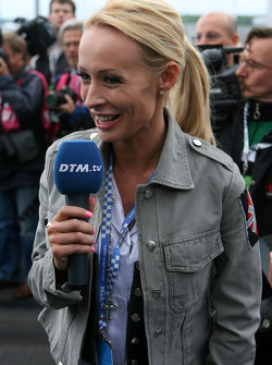 Cora Schumacher, wife of Ralf Schumacher, working on the grid for DTM TV