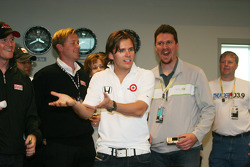Dan Wheldon works the crowd for laughs