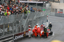 Heikki Kovalainen, McLaren Mercedes walking back to the pits after crashing out