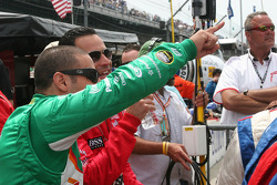 Tony Kanaan and Helio Castroneves wave to the crowd