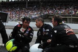 Bruno Junqueira's pit crew taking a break