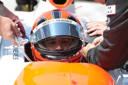 Helio Castroneves getting strapped in