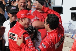 Victory lane: Helio Castroneves pours water on Ryan Briscoe