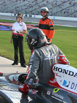 A.J. Foyt IV climbs out of the car after qualifying