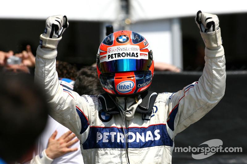Race winner Robert Kubica celebrates
