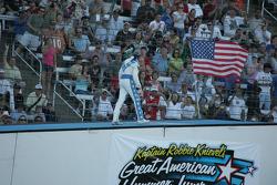 Robbie Knievel walks up his landing ramp