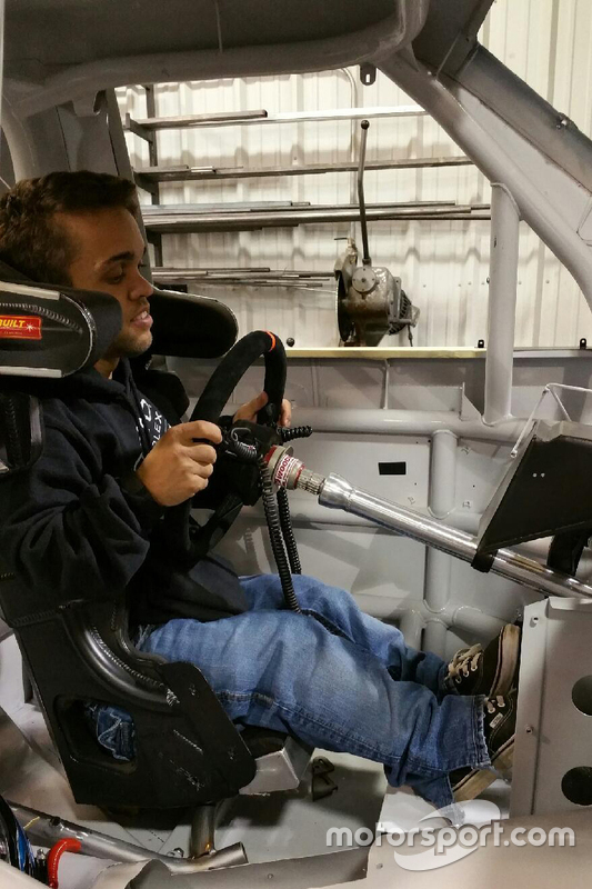 Rico Abreu is fitted into a NASCAR truck