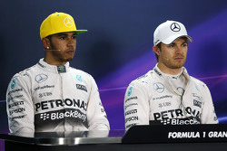 (L to R): Lewis Hamilton, Mercedes AMG F1 with team mate Nico Rosberg, Mercedes AMG F1 in the post qualifying FIA Press Conference