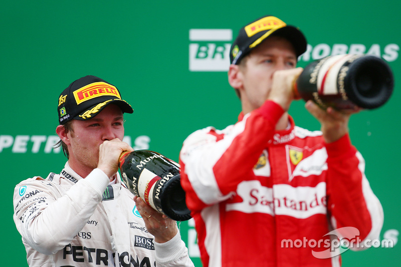 Podium: winner Nico Rosberg, Mercedes AMG F1 W06 with third place Sebastian Vettel, Ferrari SF15-T