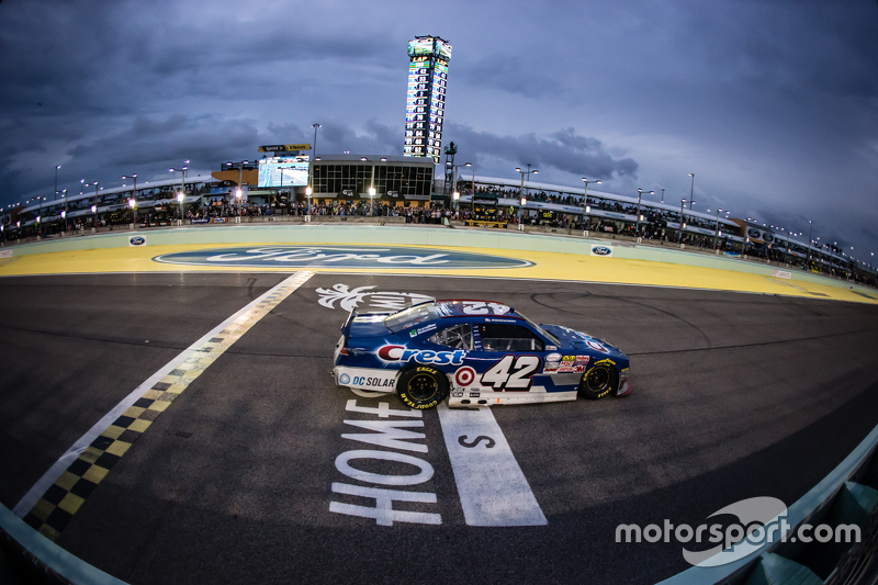 Kyle Larson, HScott Motorsports with Chip Ganassi crosses the finish line to win the race
