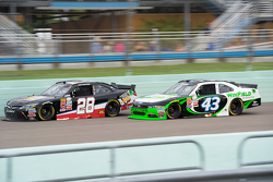 J.J. Yeley, JGL Racing Toyota and Dakoda Armstrong, Richard Petty Motorsports Ford