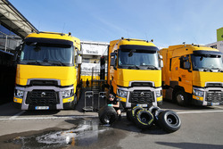 Renault Sport F1 Team trucks and Pirelli tyres washed by a mechanic in the paddock