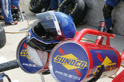 Two cans of Sunoco fuel and fuling helemt