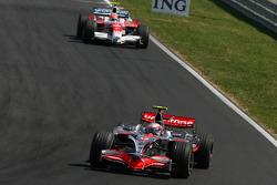 Heikki Kovalainen, McLaren Mercedes, MP4-23 and Timo Glock, Toyota F1 Team, TF108
