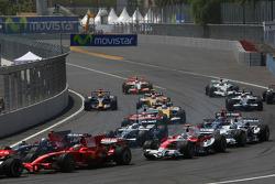 Kimi Raikkonen, Scuderia Ferrari, F2008 and Jarno Trulli, Toyota Racing, TF108
