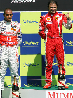 Podium: race winner Felipe Massa and second place Lewis Hamilton