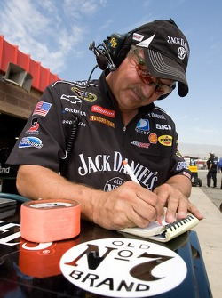 A Jack Daniel's crew member takes notes during practice