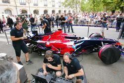 Scuderia Toro Rosso team members prepare the STR03 for the run