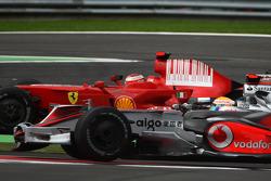 Kimi Raikkonen, Scuderia Ferrari, F2008 overtakes  Lewis Hamilton, McLaren Mercedes, MP4-23