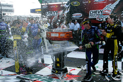 Victory lane: race winner Jimmie Johnson celebrates with champagne
