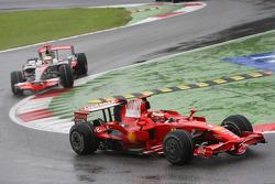 Kimi Raikkonen, Scuderia Ferrari, F2008 leads Lewis Hamilton, McLaren Mercedes, MP4-23