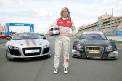 Maria de Villota poses with an Audi R8 and an Audi A4 DTM
