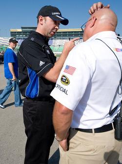Chad Knaus talks with a NASCAR official