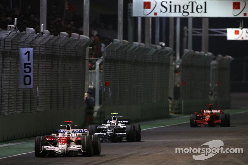 Jarno Trulli, Toyota F1 Team; Kazuki Nakajima, Williams F1 Team