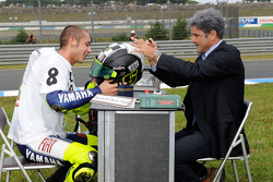 Race winner and 2008 World Champion Valentino Rossi signs and authenticates his helmet