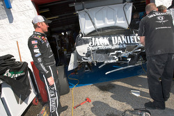 Clint Bowyer inspects the damage on his car