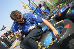 Miller Lite Dodge crew member prepares wheels