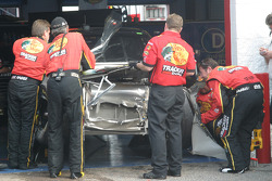 Bass Pro Shops Chevy in the garage for damage repair