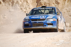 #7 Al-Me'mari Rally Team Mitsubishi Lancer Evo 9: Roger Feghali and Giovanni Bernacchinni