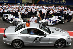 The safety car goes past the BMW team photo