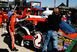 Tony Stewart surveys the damage to his Home Depot Toyota after blowing a tire in practice