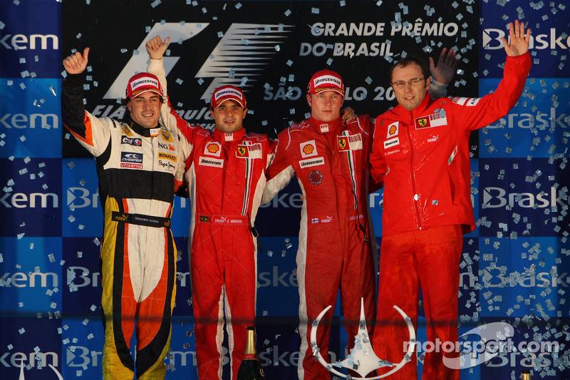 Podium: race winner Felipe Massa, second place Fernando Alonso, third place Kimi Raikkonen, and Scuderia Ferrari Sporting Director Stefano Domenicali