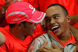 2008 World Champion Lewis Hamilton celebrates with his brother Nicolas